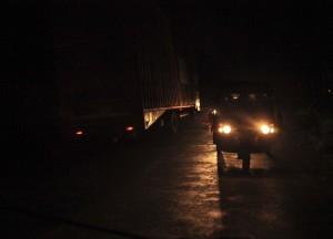 Nirav driving rickshaw at night